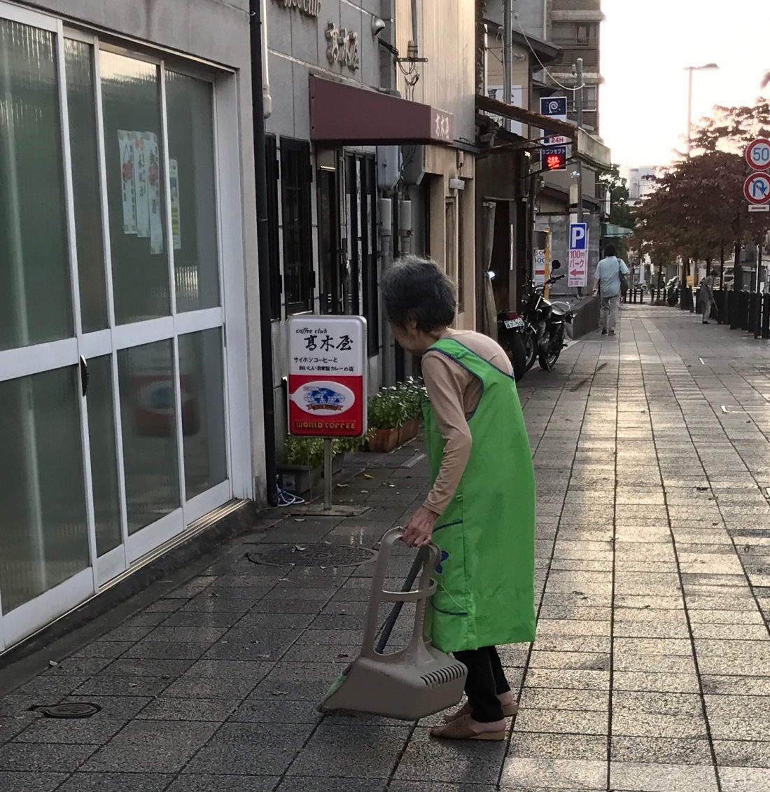 faces woman shop streetcleaner in morning kyoto blog